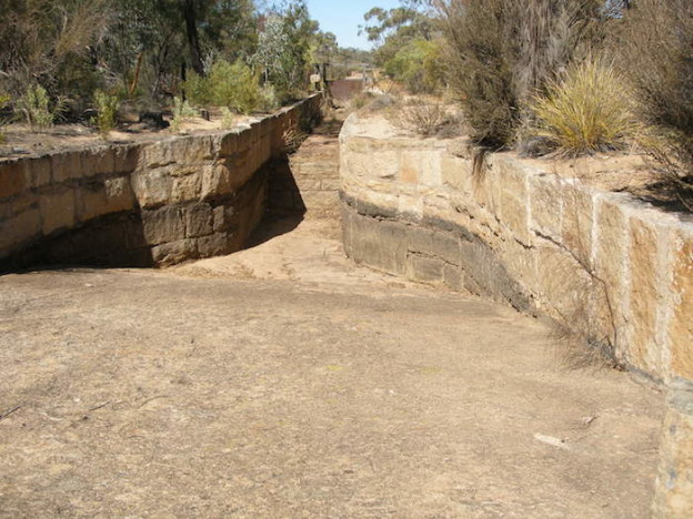 Diverting water from the rock to the aquaduct.