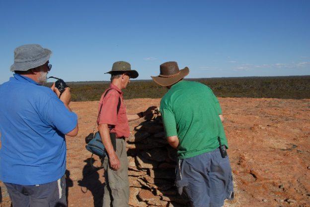 Inspecting Surveyor Johnston's cairn on the summit of Yerdanie Rock.